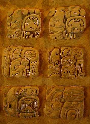Maya Glyphs carved in a stone